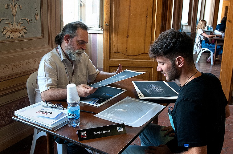 Sandro Iovine, director of FPmag, during the Portfolio reviews organized within Cortona On The Move 2016. © Stefania Biamonti/FPmag.