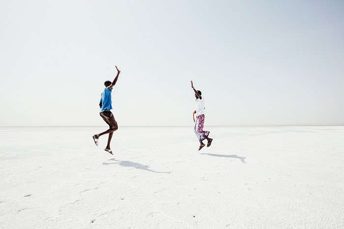Andrea Frazzetta, Assal, Salt Plain. The white surface of the Salt Lake. © Andrea Frazzetta. Ali meets his friend Mohamed who also works as a guide for tourists in the Danakil. Happy to meet again, they improvise a Keke dance