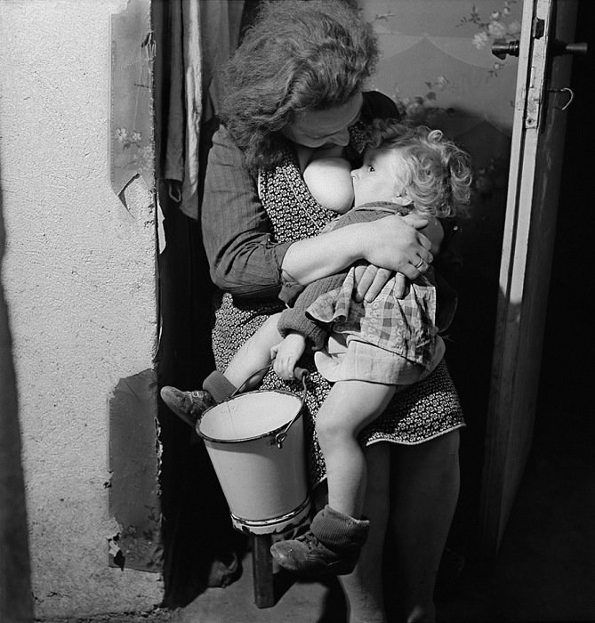 Werner Bischof, A mother breastfeeding her child as long as possible, to save him from malnutrition, Bonn, Germany, 1946. © Werner Bischof/Magnum Photos