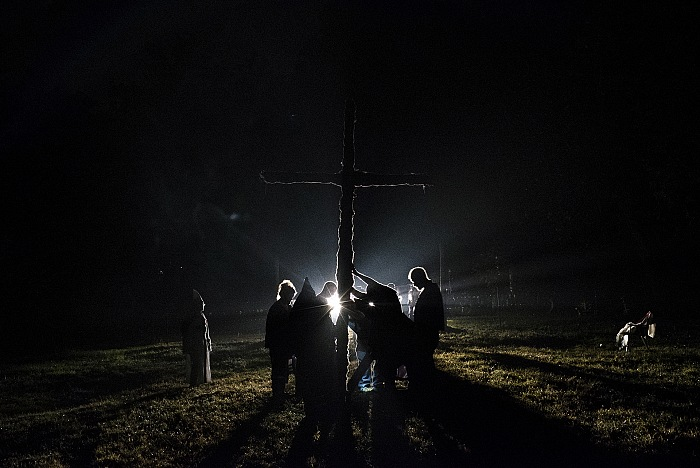 Tennessee. USA, 2015. A cross lighting after the wedding of two members of the KKK. For the KKK, the cross symbolizes Jesus Christ lighting their path (though burning the cross is taboo in most sects of Christianity). Through the history of the KKK it has also often been burned on the property of African Americans in order to intimidate them. © Peter Van Agtmael/Magnum Photos.