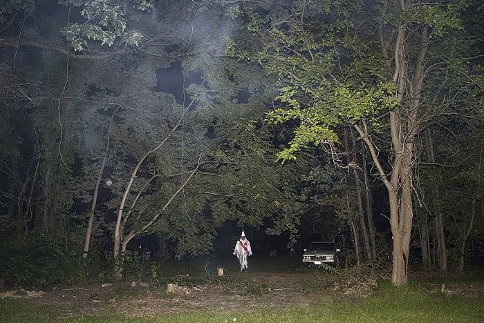 Maryland. USA, 2015. A member of the KKK after a cross lighting/burning. © Peter Van Agtmael/Magnum Photos.
