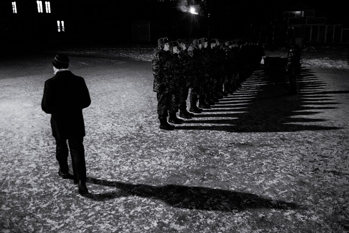At night, after serving dinner at the canteen, roll call is done for those who attend the military Academy inside the community. A strict physical, moral and intellectual discipline is required. No education is to be considered complete if it doesn't include this element. From the serie Isle of Salvation by Francesco Comello, winner of World.Report Award 2016, Spot Light Award category. © Francesco Comello.